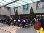 Kid's orchestra rockin' the holiday classic old school, Financial District