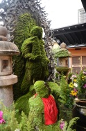 Moss covered statues in Dotonbori